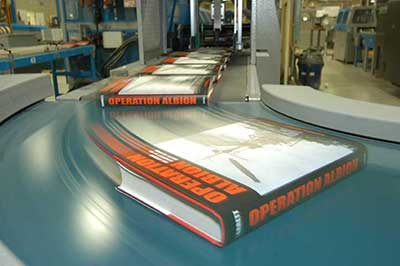 Quality case bound books in the manufacturing process at Thomson-Shore.